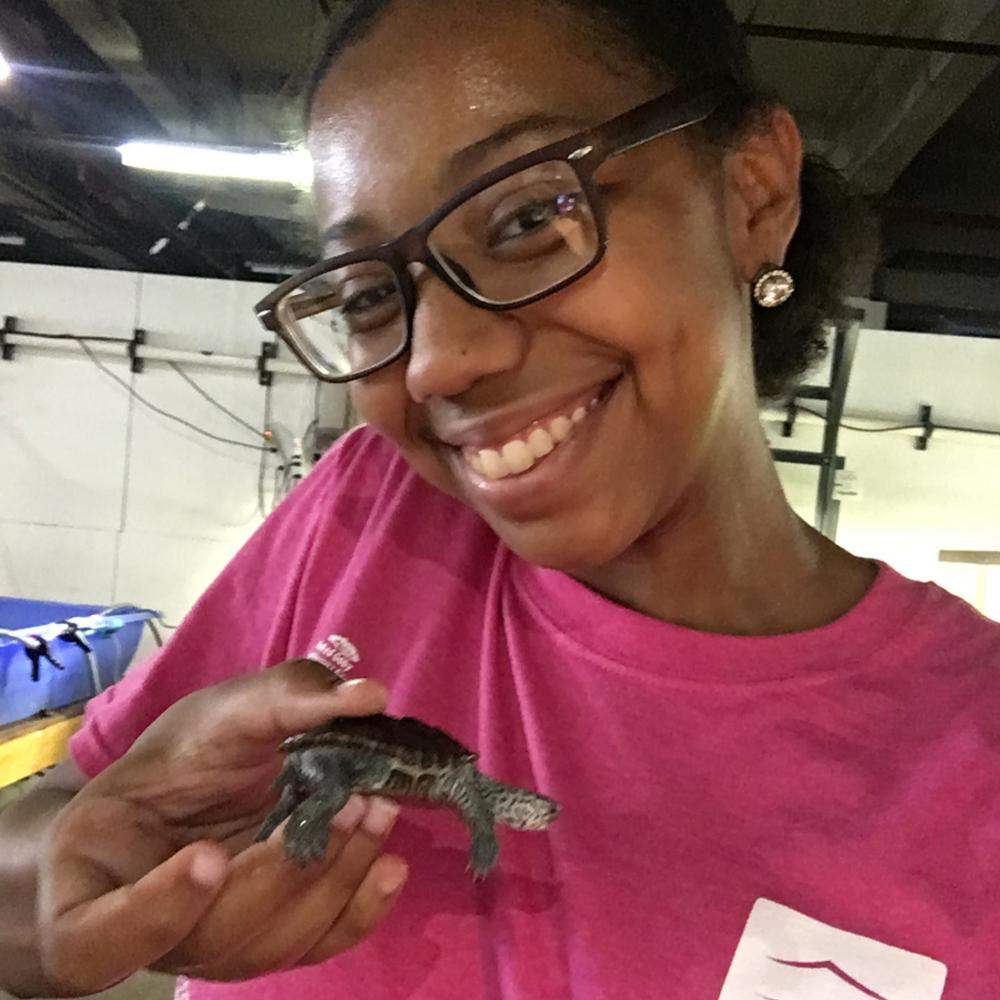 D'Leslie with a turtle